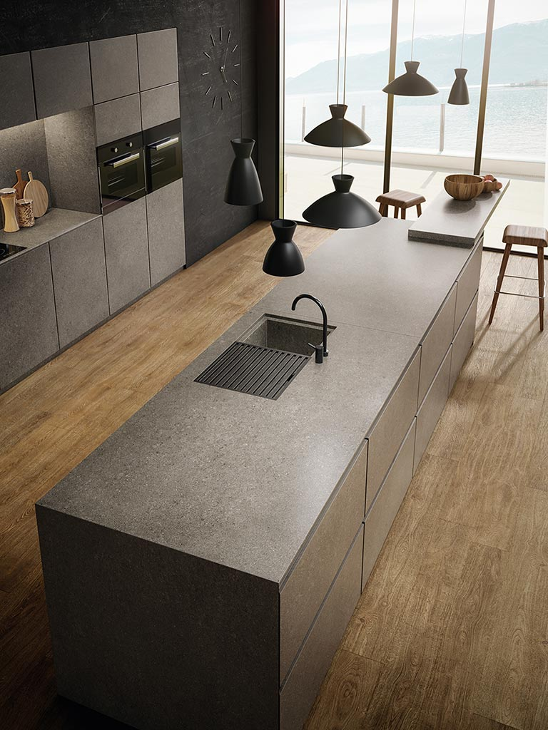 kone-grey-kitchen-cabinets-large-stone-look-slabs